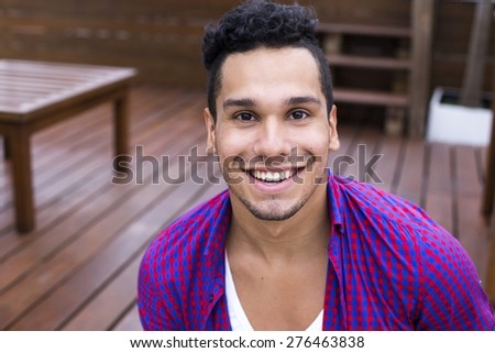 Handsome young man with hipster style - stock photo