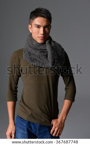 handsome young man with scarf standing
