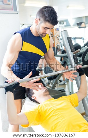 Handsome young man working out at the gym