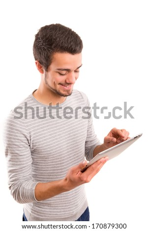 Handsome young man working with a tablet computer - stock photo