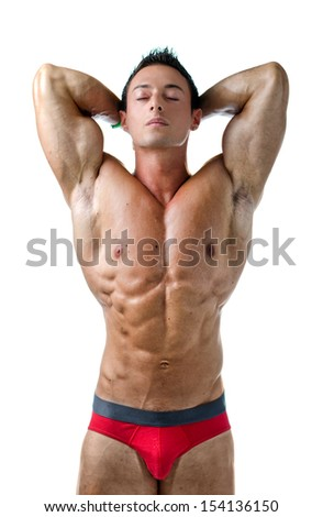 Handsome young muscle man naked with eyes closed and hands behind his head, isolated