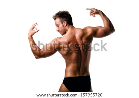 Handsome young muscle man showing muscular back and arms in a pose isolated on white - stock photo