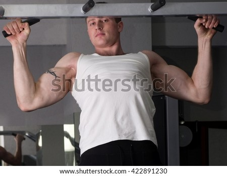 Handsome young muscular sports man in gymnasium  - stock photo