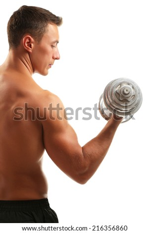 Handsome young muscular sportsman execute exercise with dumbbells isolated on white - stock photo