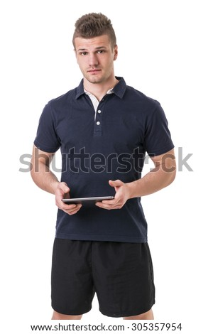 Handsome young personal trainer with tablet PC, standing isolated on white background - stock photo