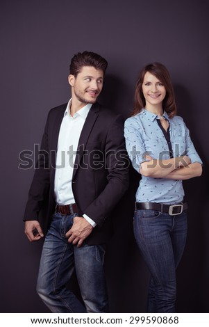 Handsome Young Professional Guy Admiring her Smiling Pretty Woman Against Gray Wall Background. - stock photo