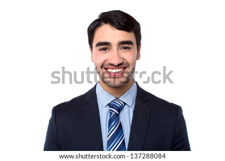 Handsome young smiling businessman isolated over white background.