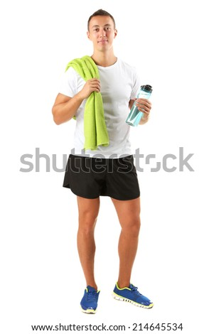 Handsome young sportsman holding towel and bottle with water isolated on white - stock photo