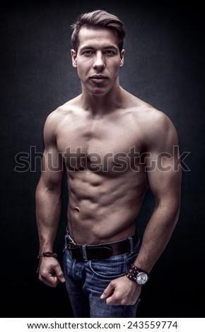 Handsome young strong man posing bare chest - stock photo