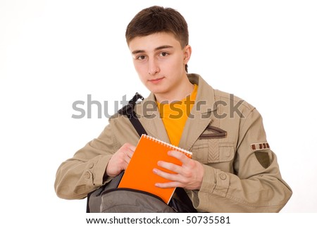 handsome young student with a notebook on a white background