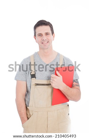 Handsome Young Worker, Holding Inventory Reports, Looking at Camera Isolated on White.