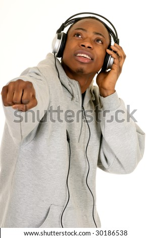 Handsome youngster, black African American teenager with headset, hip hop urban culture.  Studio white background - stock photo