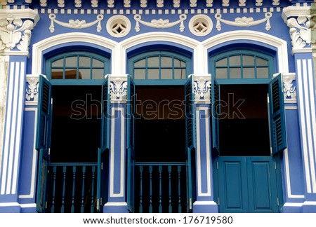 Handsomely restored former shop house with classical swags and columns on Dunlop Road in Singapore's Little India district - stock photo