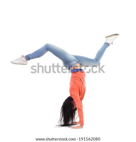Handstand of an acrobatic breakdancer. Full length studio shot isolated on white. - stock photo