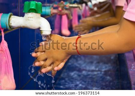Handwashing, Teachers that schools are teaching children to wash their hands - stock photo