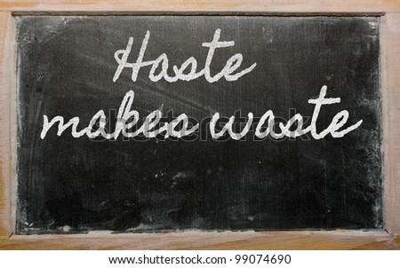 handwriting blackboard writings - Haste makes waste - stock photo
