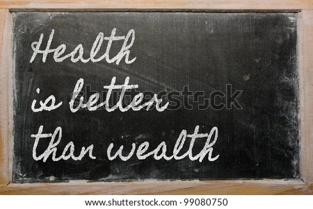 handwriting blackboard writings - Health is better than wealth - stock photo