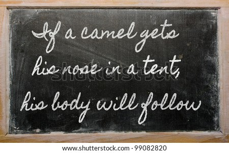 handwriting blackboard writings - If a camel gets his nose in a tent, his body will  follow - stock photo