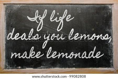 handwriting blackboard writings - If life deals you lemons, make lemonade - stock photo