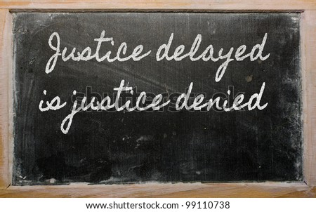handwriting blackboard writings - Justice delayed is justice denied - stock photo