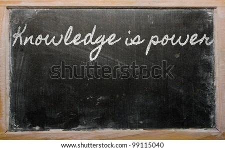 handwriting blackboard writings - Knowledge is power - stock photo