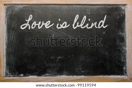 handwriting blackboard writings - Love is blind - stock photo