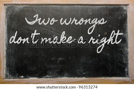handwriting blackboard writings - Two wrongs don't make a right - stock photo