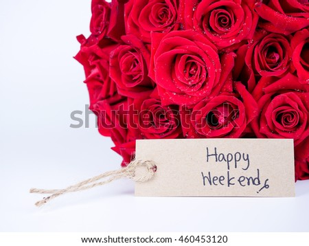 Handwriting Happy Weekend on brown label and bouquet of red rose flower on isolated / white background - stock photo