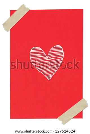 Handwriting heart shape on red paper with tape - stock photo