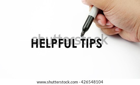 "Handwriting "" helpful tips "" with the hand and pen isolated in white background."