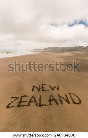 handwriting in sand on New Zealand coast