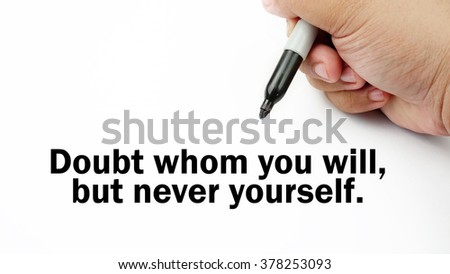 "Handwriting of inspirational motivation quotes ""Doubt whom you will,but never yourself"". This quotes use to motivate people to always strive for success."