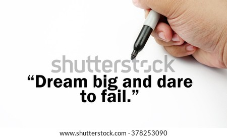 "Handwriting of inspirational motivation quotes ""Dream big and dare to fail"". This quotes use to motivate people to always strive for success."