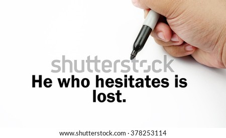 "Handwriting of inspirational motivation quotes ""He who hesitate is lost"". This quotes use to motivate people to always strive for success."