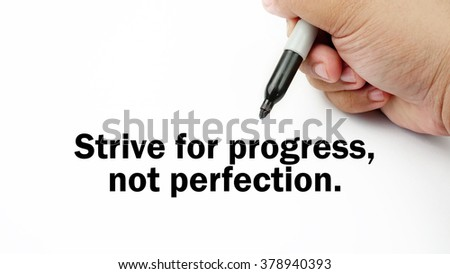 "Handwriting of inspirational motivation quotes ""strive for progress not perfection"". This quotes use to motivate people to always strive for good life."