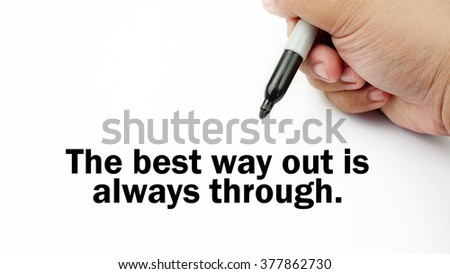 "Handwriting of inspirational motivation quotes ""the best way out is always through"". This quotes use to motivate people to always strive for success."