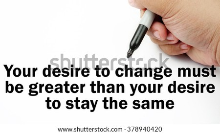 """Handwriting of inspirational motivation quotes """"your desire to change must be greater than your desire to stay the same"""". This quotes use to motivate people to have good life. - stock photo"""