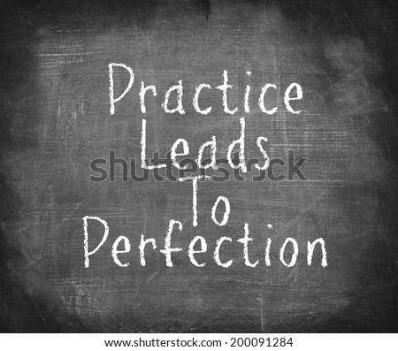 Handwriting on blackboard - Practice Leads To Perfection  - stock photo