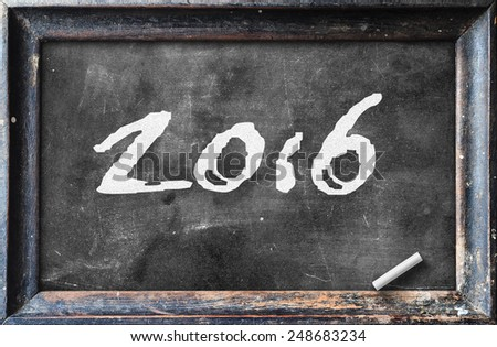 Handwriting text for 2016 on blackboard. - stock photo
