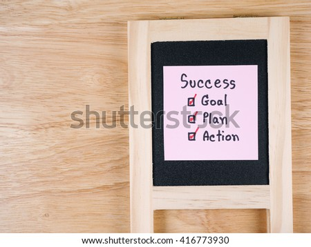 Handwriting word Success, Goal, Plan, Action on colorful notepaper and black board with wood background (Business concept) - stock photo
