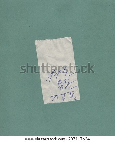 handwritten bill or receipt isolated over green blue background - stock photo