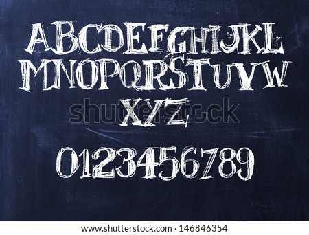 Handwritten chalk ABC on a blackboard - stock photo