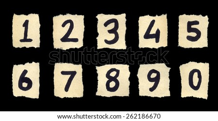 Handwritten digits over old paper. Isolated on black background. - stock photo