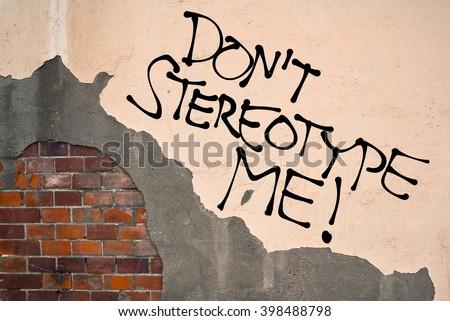 Handwritten graffiti Don't Stereotype Me! sprayed on the wall, anarchist aesthetics  - stock photo