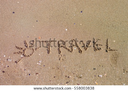 Handwritten inscription on sea sand, close up view
