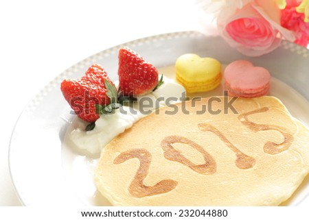 handwritten new year card and pan cake art for 2015 - stock photo