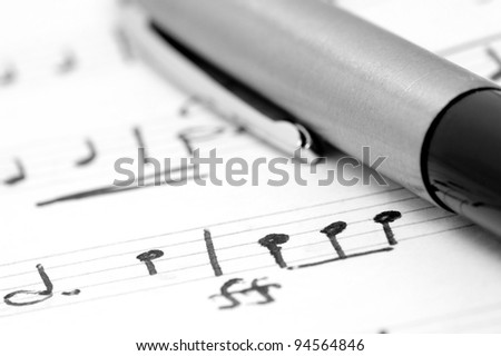 Handwritten notation. - stock photo