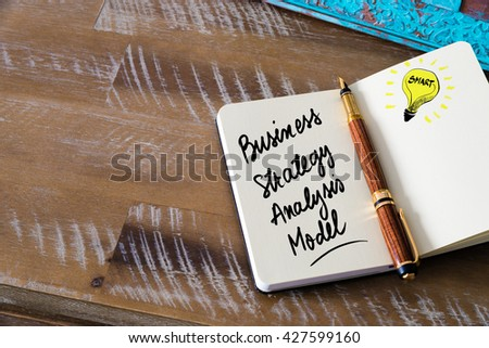 Handwritten text Business Strategy Analysis Model with fountain pen on notebook. Concept image with copy space available. - stock photo