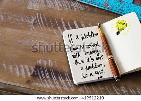 Handwritten text If a problem can be solved with money, then it i??s not a problem but a cost with fountain pen on notebook. Concept image with copy space available. - stock photo