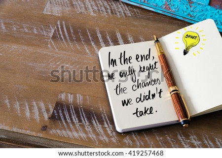 Handwritten text In the end, we only regret the chances we did not take with fountain pen on notebook. Concept image with copy space available. - stock photo